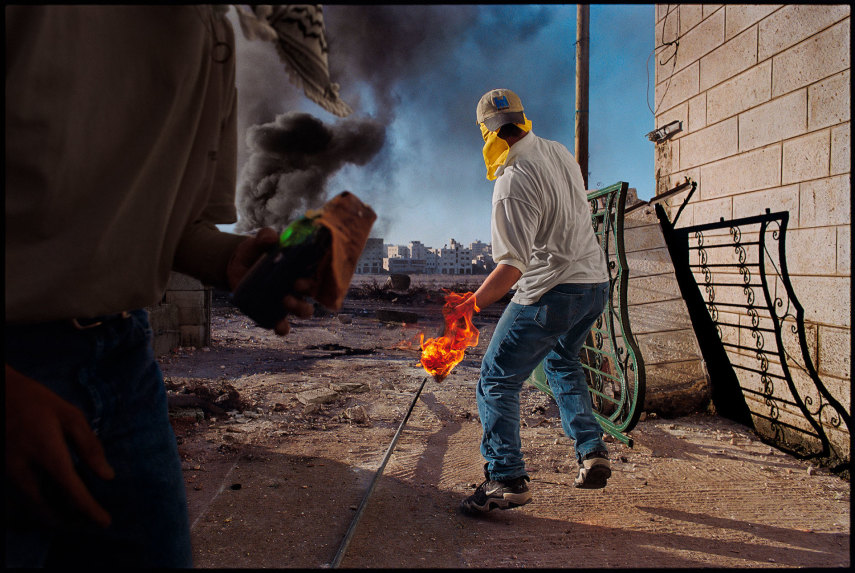 Ramallah, West Bank, 2000. At the beginning of the second Palestinian uprising, demonstrators hurled Molotovs at Israeli troops.
